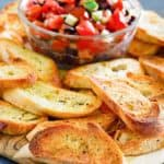homemade crostini and a bowl of chopped tomato topping