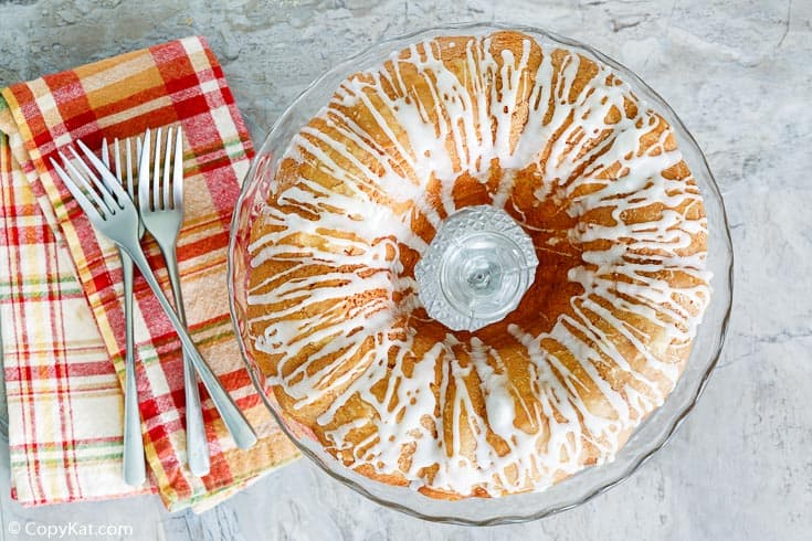 golden pound cake with forks and napkins next to it
