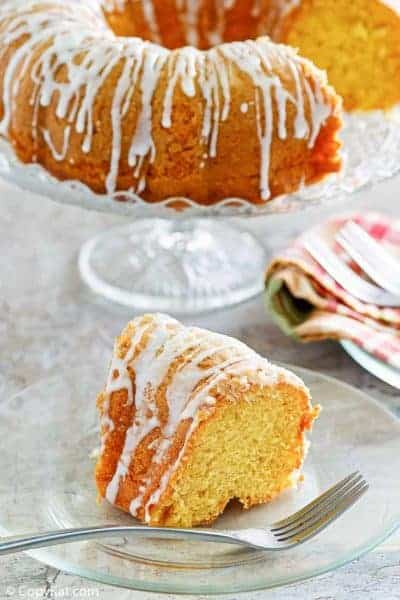 a slice of golden pound cake in front of the cake