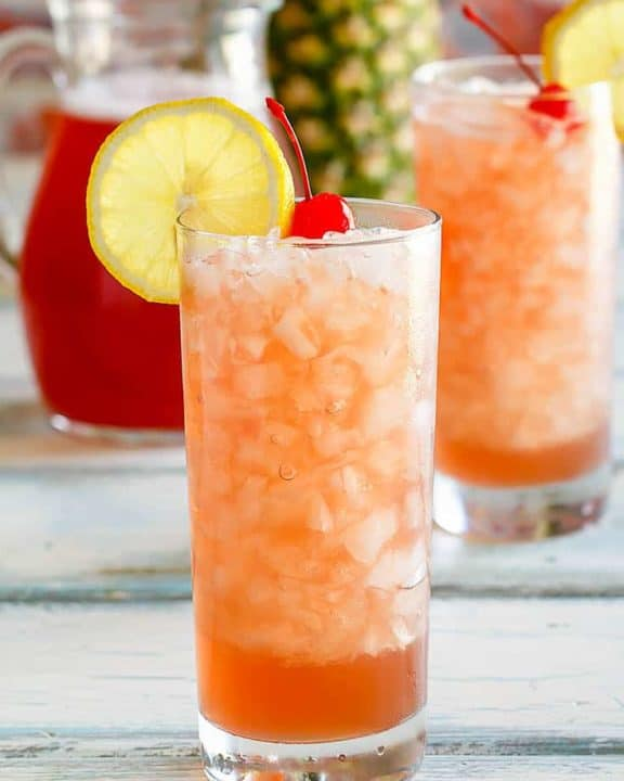 two glasses and a pitcher of homemade Joe's Crab Shack secret passion punch