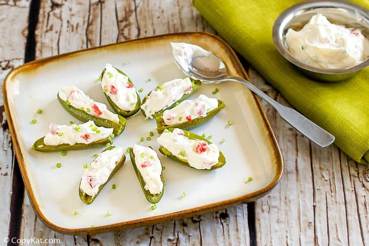 a plate of cream cheese filled fresh jalapeno peppers