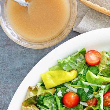 homemade Luigetta's salad dressing next to a salad