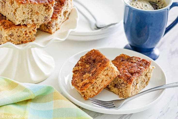 slices of rhubarb coffee cake on a plate and on a cake stand
