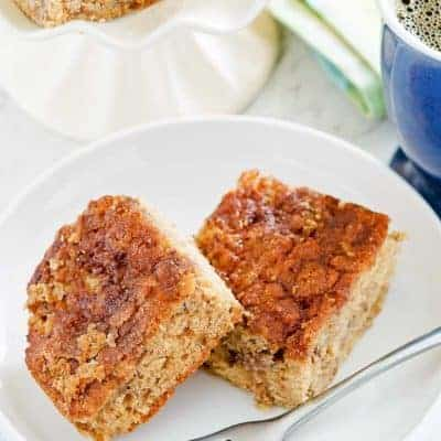 two pieces of rhubarb coffee cake on a plate