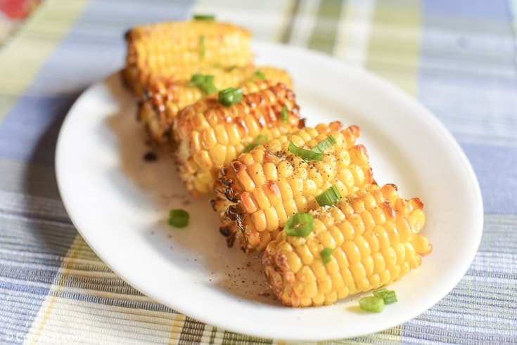 a platter with air fried corn on the cob