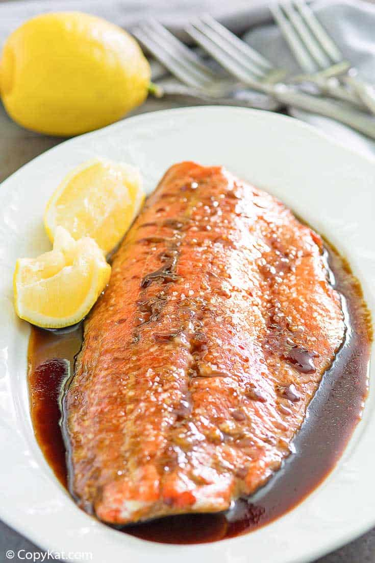 baked salmon with sauce on a platter