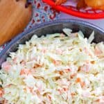 a bowl of homemade Captain D's cole slaw and hush puppies