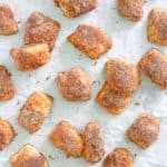 overhead view of cinnamon sugar pretzel bites on parchment paper