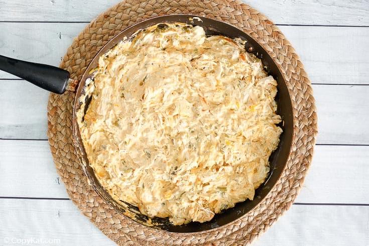 cream cheese chicken enchiladas filling mixture in a skillet