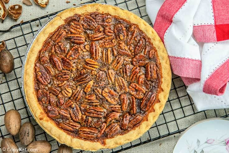 a whole pecan pie on a wire rack