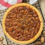 a whole pecan pie on a wire cooling rack