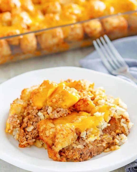 a serving of hamburger tater tot casserole on a white plate