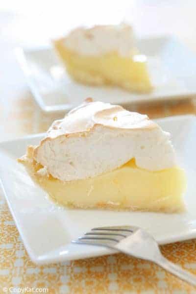 Two slices of lemon meringue pie