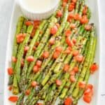 Parmesan roasted asparagus with chopped tomatoes and cheese sauce
