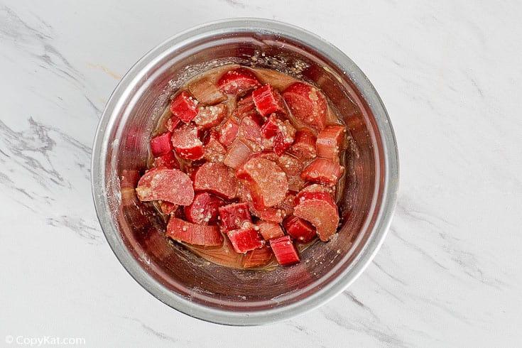 rhubarb custard pie filling in a mixing bowl