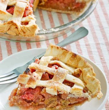 a slice of rhubarb custard pie on a plate next to the pie