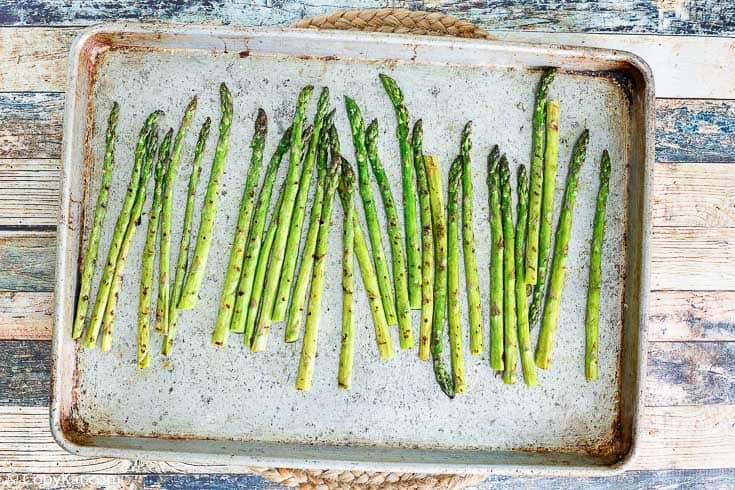 roasted asparagus on a baking sheet
