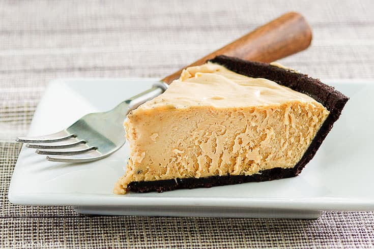 a slice of peanut butter pie and a fork on a plate