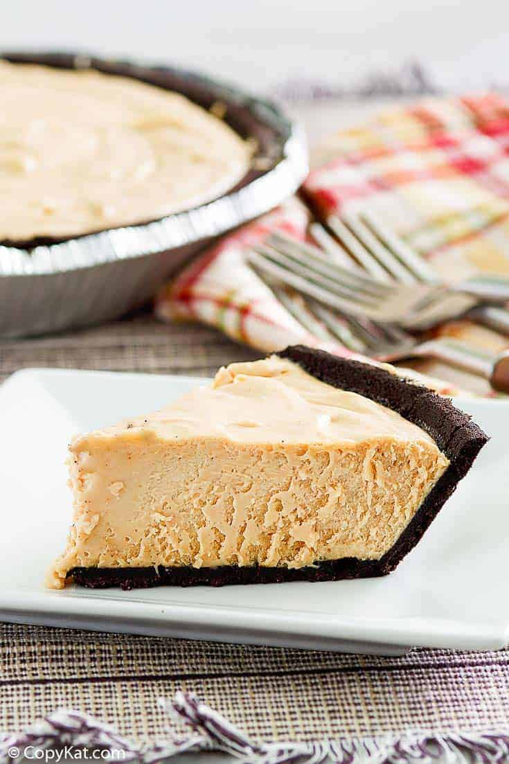 a slice of peanut butter pie with chocolate cookie crust