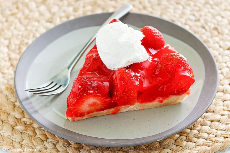 a slice of homemade Big Boy Strawberry pie and a fork on a plate