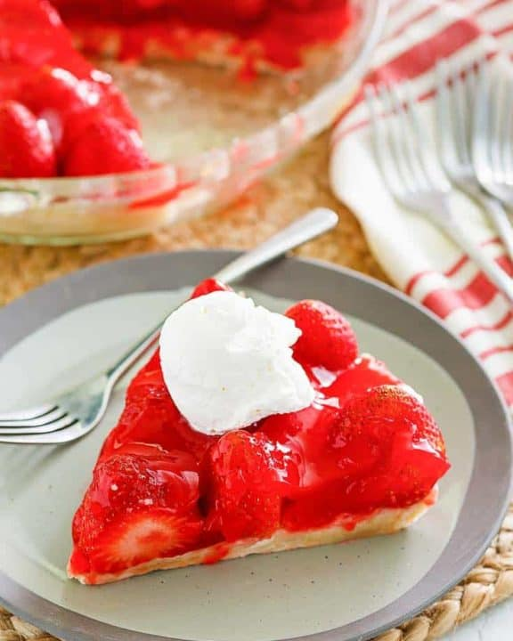 a slice of homemade Big Boy strawberry pie with a dollop of whipped cream on top