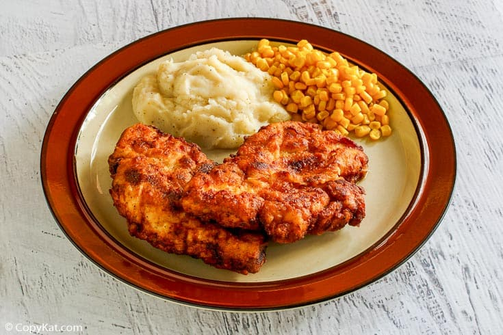 homemade Cracker Barrel homestyle fried chicken, mashed potatoes, and corn on a plate