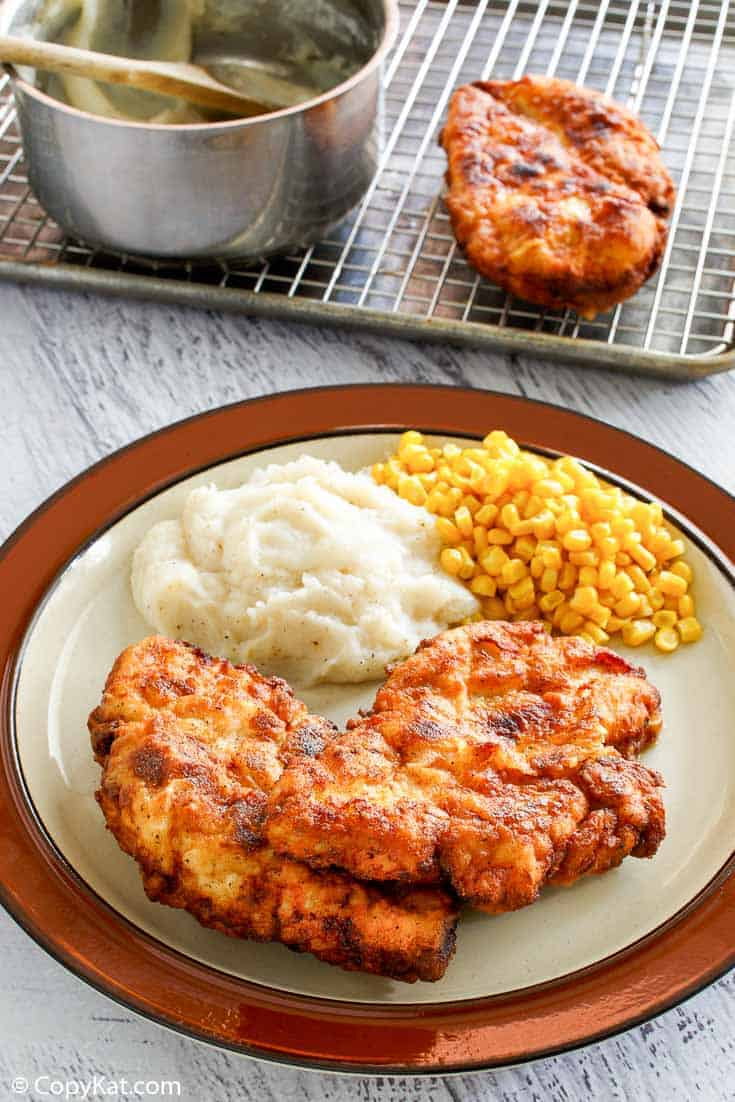homestyle fried chicken, mashed potatoes, and corn on a plate