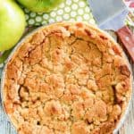 a whole Dutch apple pie, green apples, and a pie server