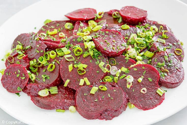 marinated beet salad topped with green onions