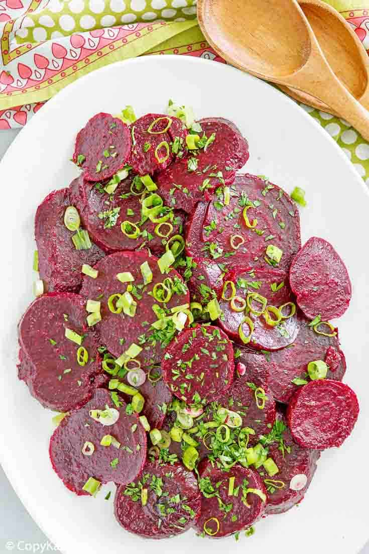 overhead view of marinated beet salad on a platter