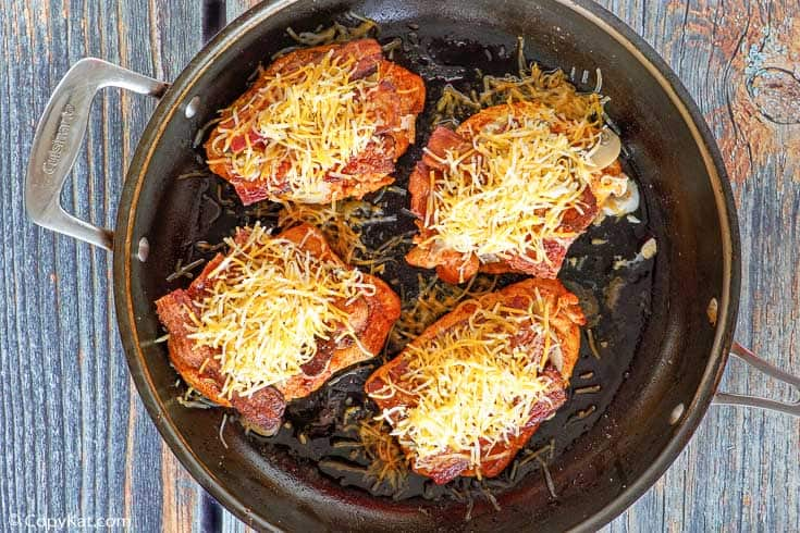 Alice Springs Chicken in a skillet before melting cheese on top