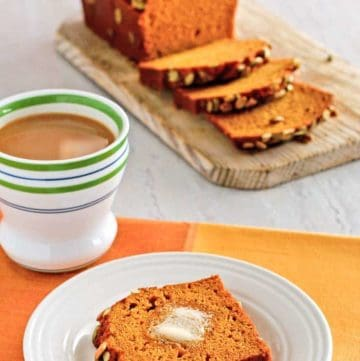 homemade Starbucks pumpkin bread on a plate and cutting board