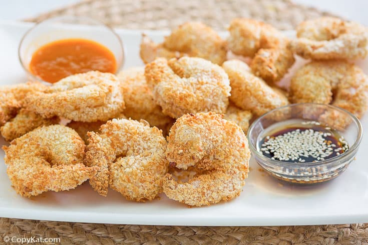 air fried panko breaded shrimp and dipping sauces on a platter