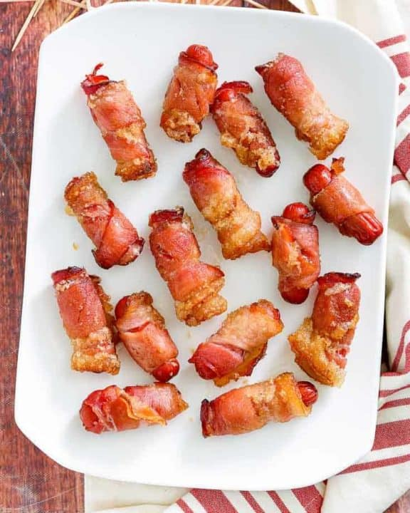 overhead view of bacon wrapped little smokies on a platter