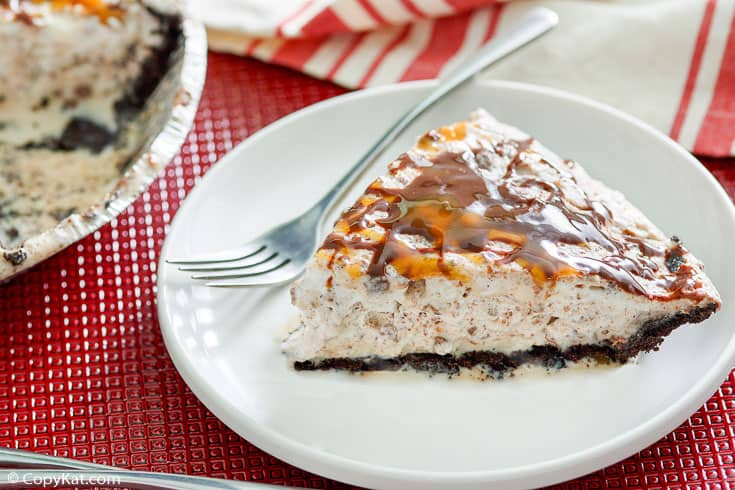 a slice of ice cream pie and a fork on a plate