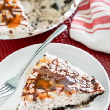 a slice of ice cream pie with toffee and chocolate chips and Oreo crust