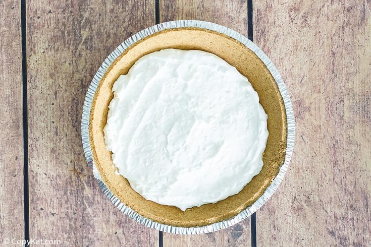 cheesecake layer in a graham cracker crust