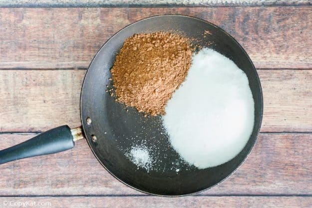 Ingredients for homemade Hershey's chocolate syrup in a skillet