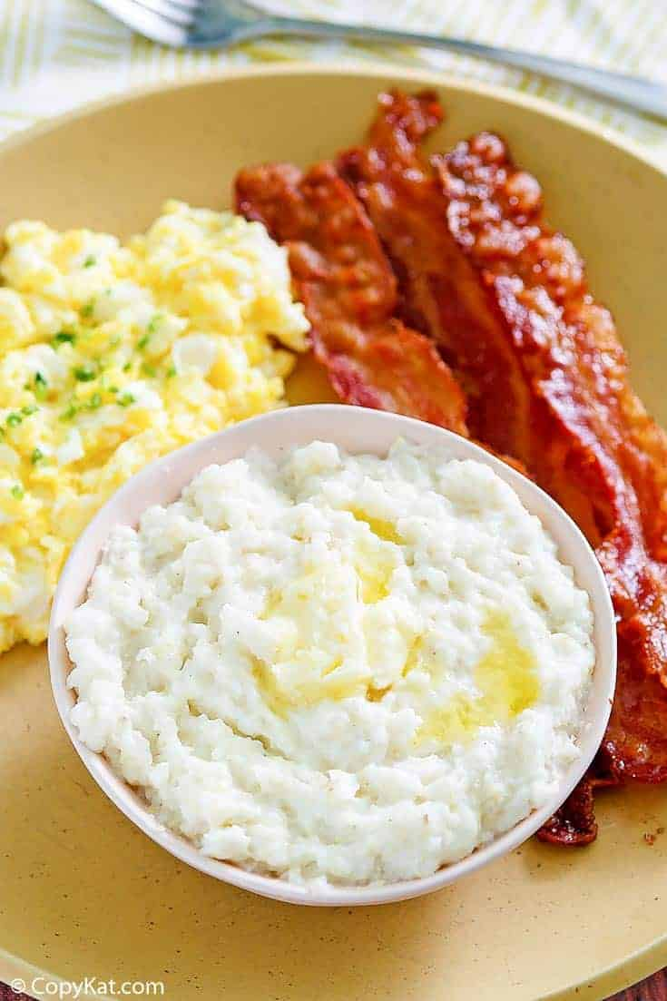 bacon, eggs, and grits on a plate
