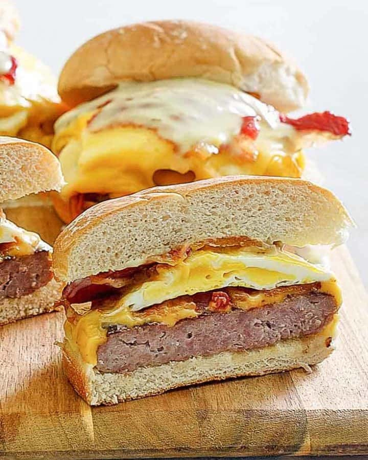 homemade Wendys Breakfast Baconator Sandwiches on a wood board