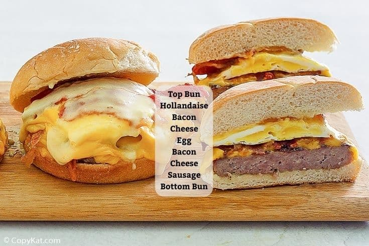 two homemade Wendy's Breakfast Baconator sandwiches with list of ingredients