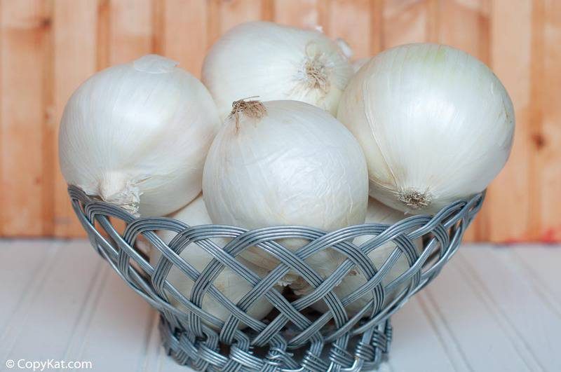 white onions in a metal basket