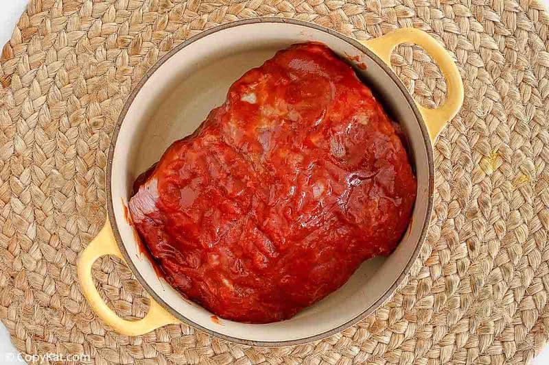 barbacoa marinade on beef in a pot