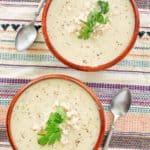 overhead view of two bowls of crab bisque