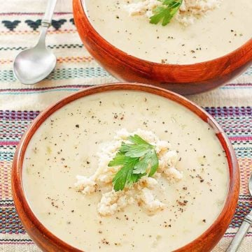 two bowls of crab bisque and two spoons