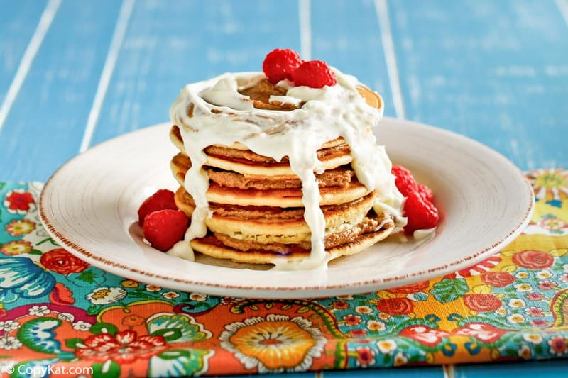 a stack of cinnamon pancakes with cream cheese icing