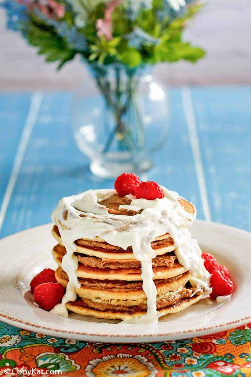 a stack of homemade IHOP Cinnastack pancakes with cream cheese icing