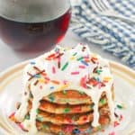 funfetti pancakes with icing and syrup