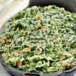 creamed spinach with bacon in a serving dish
