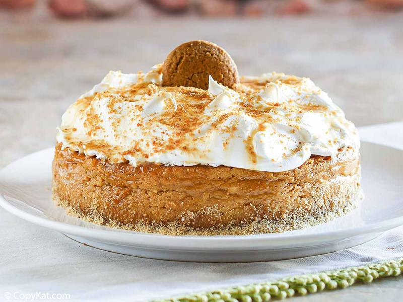a pumpkin pie cheesecake topped with whipped cream